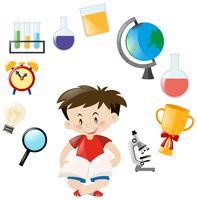 Menino bonito e objetos escolares diferentes vetor