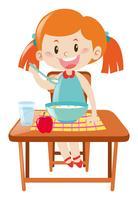 Garota na mesa de jantar comendo vetor