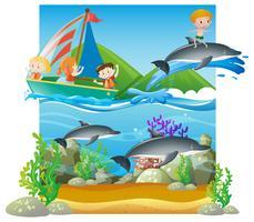 Cena de verão com crianças e golfinhos vetor