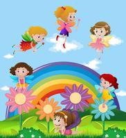 Fadas voando sobre o arco-íris vetor