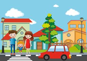Família atravessando rua na aldeia vetor