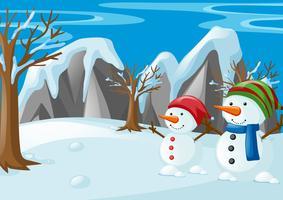 Dois bonecos de neve no campo de neve vetor
