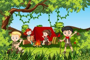 Canping crianças na floresta vetor