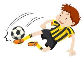 Jogador de futebol chutando a bola vetor
