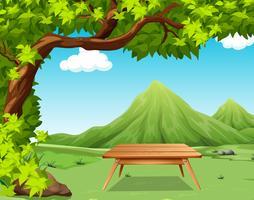 Cena da natureza com mesa de piquenique no parque vetor