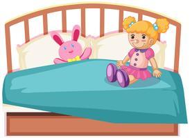 Bonitos brinquedos na cama vetor