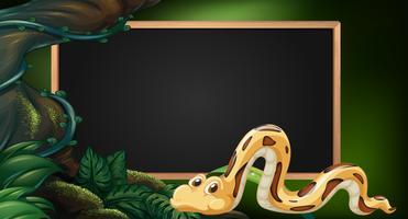 Quadro-negro com cobra na selva como pano de fundo
