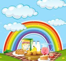 Diferentes tipos de café da manhã no campo com arco-íris no fundo vetor