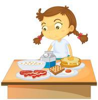 Uma menina tomando café da manhã no fundo branco vetor