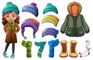 Menina e diferentes tipos de roupas de inverno vetor