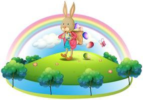 Um coelho com uma cesta de ovos vetor