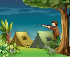 Um caçador em um acampamento vetor