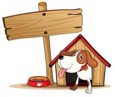 Uma sinalização ao lado de uma casa de cachorro