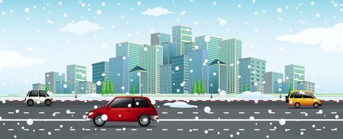 Cena da cidade com neve caindo na estrada vetor