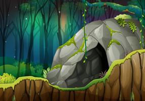Caverna de pedra na floresta escura vetor