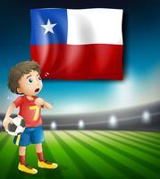 Jogador de futebol na frente da bandeira do chile vetor