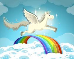 Pegasus voando sobre o arco-íris vetor