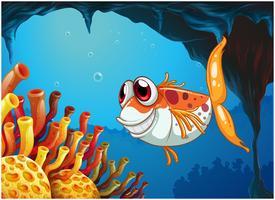 Um peixe sorridente sob o mar dentro da caverna