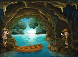 Jovens exploradores dentro da caverna vetor