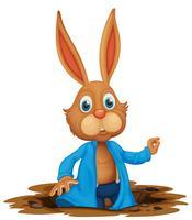 Um coelho fofo no buraco vetor