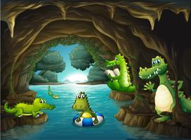 Crocodilos nadando na caverna
