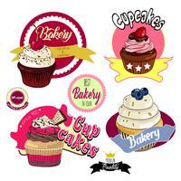 Emblemas de padaria vintage cupcakes e rótulos. vetor