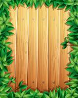 Design de fronteira com folhas verdes na parede de madeira