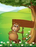 Um castor em pé debaixo da árvore com um tabuleiro vazio