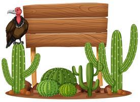 Sinal de madeira e abutre no jardim de cactos