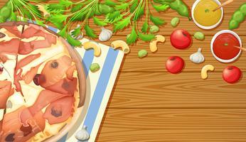 Pizza de presunto de Parma na mesa de madeira