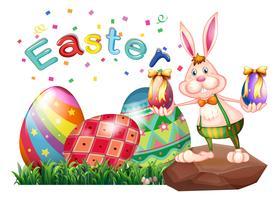 Um coelho acima da rocha com ovos de páscoa vetor