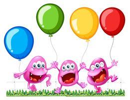 Três monstros brincando com balões vetor