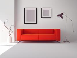 Sofá vermelho com molduras e abajur
