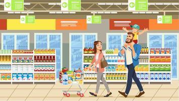 Família de compras no supermercado com carrinho de produtos