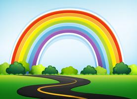 Bela natureza na estrada e arco-íris vetor