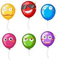 Balões coloridos com diferentes emoções faciais vetor