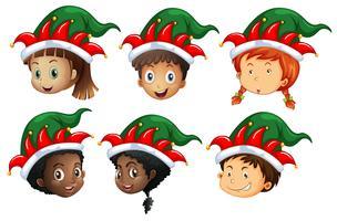Tema de Natal com crianças em chapéus de elfo vetor