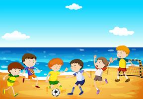 Meninos jogando futebol na praia vetor