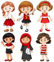 Meninas em trajes vermelhos e pretos