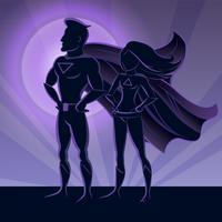 Silhuetas de casal super-herói vetor