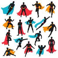 Conjunto de silhuetas de super-herói preto vetor