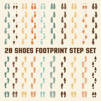 Conjunto de pegadas coloridas de pegadas de sapatos vetor