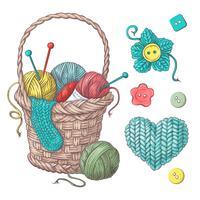 Conjunto para cesta artesanal com bolas de fio, elementos e acessórios para crochê e tricô.