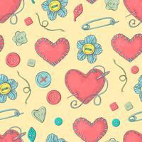 Cama de agulha costurada na forma de um coração e acessórios de costura.