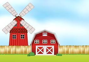 Cena de fazenda com moinho de vento e celeiro