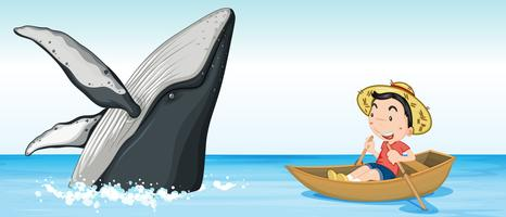 Menino no barco ao lado da baleia vetor