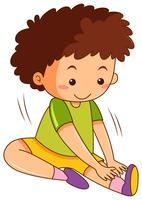 Um menino que estica exercícios