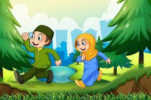 Menino muçulmano e menina no parque vetor