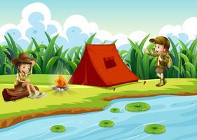 Kids camping pela água com uma tenda vetor