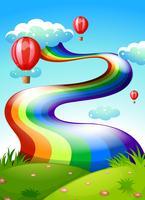 Um arco-íris e flutuando balões no céu